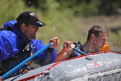 Father and son whitewater rafting on the Snake River in Jackson Hole Wyoming