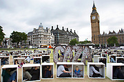 London, UK, Thursday 14th August 2014. In Parliament Square, 150 men, women and children are squashed inside boxes for an Oxfam stunt to illustrate the conditions faced by the people in Gaza who are trapped by the blockade. Mike Kemp for Oxfam.