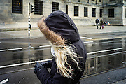 Amsterdam, The Netherlands, 19 Nov 2013, Waiting to cross the street. PHOTO © Christophe Vander Eecken