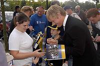Photo. Glyn Thomas,  Digitalsport<br />Wimbledon v Burnley. Nationwide Division 1.<br />National Hockey Stadium, Milton Keynes. 27/09/2003.<br />Wimbledon's Lee Morgan signs autographs for fans outside his team's new stadium.