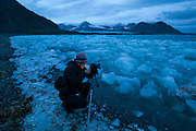 Rafal Flieger photographs the ice deposited along the coast, calved by Hansbreen, near the Polish Polar Station in Hornsund, Svalbard.