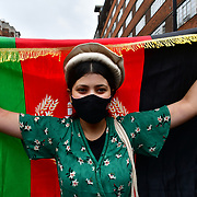 """Marble Arch, London, UK. 2021-08-21. Hundreds most young Afghans in London March in solidarity with Afghanistan - Stop proxy war. Afghanistan want peace. I hope the Afghans will united and build a new Afghanistan dont`t let the invaders """"divide and rule"""" lost the war to Afghans victory party Afghanistan again."""