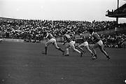 17/08/1969<br /> 08/17/1969<br /> 17 August 1969<br /> All-Ireland Senior Semi-Final: Kilkenny v London at Croke Park, Dublin.<br /> Kilkenny forwards (in center) and london players follow the ball near the London goalmouth. Players are: London's P. O'Fathaigh (left) and Kilkenny's S.O. Maolaoidh (13).