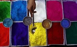 November 3, 2018 - Kathmandu, Nepal - A vendor picks vermillion colors for a customer for the upcoming Tihar festival at a street market in Kathmandu on Saturday, November 03, 2018. (Credit Image: © Skanda Gautam/ZUMA Wire)