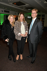 Left to right, KATHERINE STABLES, EVE HENDERSON & TOM HENDERSON at a film screening in aid of the charity Women for Women held at BAFTA, 195 Piccadilly, London on 26th February 2014.
