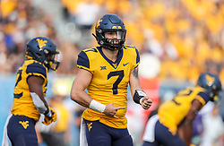 Sep 22, 2018; Morgantown, WV, USA; West Virginia Mountaineers quarterback Will Grier (7) changes a play at the line of scrimmage during the third quarter against the Kansas State Wildcats at Mountaineer Field at Milan Puskar Stadium. Mandatory Credit: Ben Queen-USA TODAY Sports