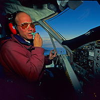 "ANTARCTICA, Queen Maud Land. Pilot Greg Stein flies Twin Otter through Fenris Mountains near Adventure Network's ""Blue 1"" expedition base."