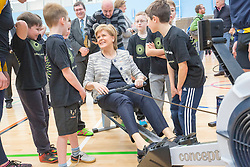 Rt Hon Nicola Sturgeon, First Minister of Scotland and internationalists from Oriam's sporting partners officially open the £33m Heriot-Watt University Edinburgh facility. Pic with kids in the sports hall.