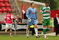 Fotball<br /> England 2005/2006<br /> Foto: SBI/Digitalsport<br /> NORWAY ONLY<br /> <br /> Swindon v Yeovil<br /> Coca Cola League 1.<br /> 27/08/2005.<br /> <br /> Swindon's Christian Roberts celebrates his scoring the forth swindon goal as Yeovil's goalie Chris Weale who came a long way out of goal walks away with dispirited team mate.