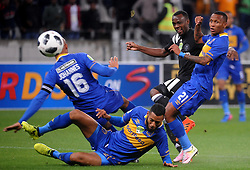Cape Town 18-03-14  Cape Town city Players Robyn Johannes Taariq fielies and Amethyst Ralani trying to stop Orlando Pirates striker Justin Shonga in the  Nedbank Cup in  Cape Town Stadium Pictures Ayanda Ndamane African news agency/ANA