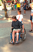 Girl in wheelchair with friend ages 9 and 12 on an outing to the city.  Zakopane Poland