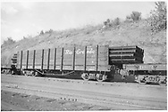 3/4 view of D&RGW high-side gondola #1139 loaded with pipe.  An idler flatcar is coupled to each end.<br /> D&RGW    ca. 1947