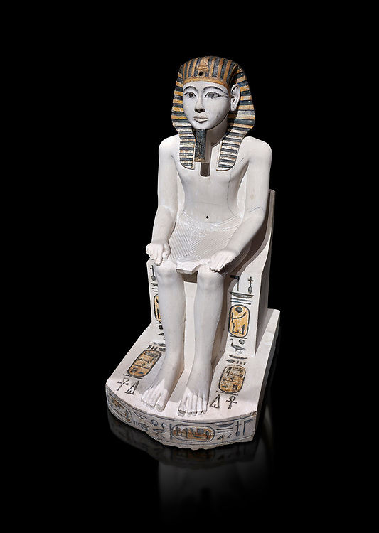 Ancient Egyptian cult statue of Amenhoptep I, limestone, New Kingdom, 19th Dynasty, (1292-1190 BC, Deir el-Medina. Egyptian Museum, Turin. black background.<br /> <br /> The cult of Amenhoptep I flourished during the 19th &20th Dynasties. This statue is typical of Theban sculpture of the Ramesside era : large eyes, full cheeks and aquiline nose. the kings skin colour is white rather than the more common red hue. This is typical of other Deir el-Medina statues of the era.  Drovetti collection. Cat 1372. .<br /> <br /> If you prefer to buy from our ALAMY PHOTO LIBRARY  Collection visit : https://www.alamy.com/portfolio/paul-williams-funkystock/ancient-egyptian-art-artefacts.html  . Type -   Turin   - into the LOWER SEARCH WITHIN GALLERY box. Refine search by adding background colour, subject etc<br /> <br /> Visit our ANCIENT WORLD PHOTO COLLECTIONS for more photos to download or buy as wall art prints https://funkystock.photoshelter.com/gallery-collection/Ancient-World-Art-Antiquities-Historic-Sites-Pictures-Images-of/C00006u26yqSkDOM