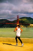 Women jogging near Marina, Golden Gate Bridge in background, San Francisco, California USA
