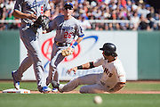 San Francisco Giants left fielder Angel Pagan (16) slides into second base against the Los Angeles Dodgers at AT&T Park in San Francisco, Calif., on October 1, 2016. (Stan Olszewski/Special to S.F. Examiner)