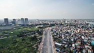 Aerial view of a motorway under construction in the outskirts of Tay Ho District, Hanoi, Vietnam, Southeast Asia
