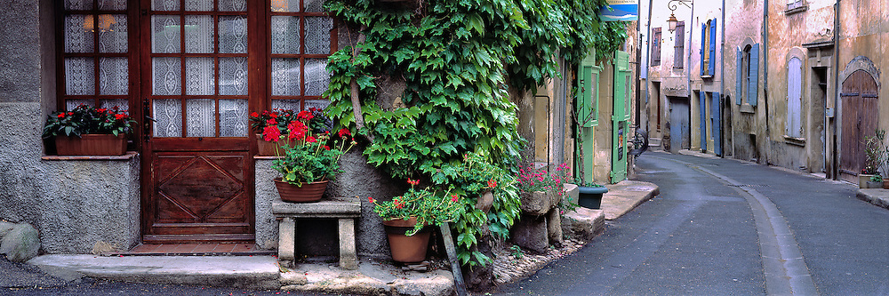 A quiet street scene in Lourmarin, France, reflects the essence of provencial village life.