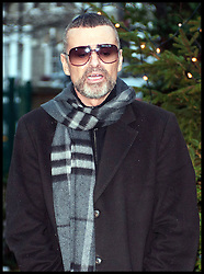 July 23, 2013 - London, United Kingdom - Photo filed Sunday 25th December 2016- It has been reported that George Michael has died- Singer George Michael has died aged 53, his publicist has said. George Michael arrives back at his home in Highgate after spending a month in Hospital in Austria with influenza, Friday December 23, 2011. Picture by  i-Images (Credit Image: © i-Images via ZUMA Wire)
