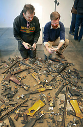 16 April 2014. Jonathan Ferrara Gallery, New Orleans, Louisiana. <br /> L/R; Artists Skyler Fein and Adam Mysock  at the Jonathan Ferrara Gallery to announce the 'Guns In The Hands Of Artists' project where artists take parts from 190 destroyed weapons acquired by the New Orleans Police department through a buy-back program and convert them into art.  <br /> Photo; Charlie Varley/varleypix.com