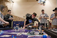 Ben Selfridge mans the controls while John Blandford keeps an eye on the LEGOSmith's/HyrdroSci robot during the First Lego League Competition at Gilford Middle School.  (Karen Bobotas/for the Laconia Daily Sun)