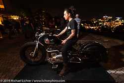 Madhouse Motors J Shia with her 1957 custom Royal Enfield Indian (Royal Enfield imported and rebadged as Indians after the Springfield factory was closed in 1953) bobber built out of J's Boston shop. The Handbuilt Show pre-party, Austin, TX. Thursday, April 11, 2019. Photography ©2019 Michael Lichter.