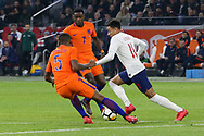 England midfielder Jesse Lingard battles with Netherlands forward Quincy Promes (Spartak Moscow),  and Netherlands Midfielder Georginio Wijnaldum (Liverpool) during the Friendly match between Netherlands and England at the Amsterdam Arena, Amsterdam, Netherlands on 23 March 2018. Picture by Phil Duncan.