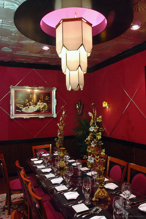 The private Platinum Room at Jeff Ruby's in Louisville, Ky., features bronze Art Deco elevator doors from the Chrysler Building, a 6' Art Deco wedding cake chandelier from Detroit's Cadillac Hotel and suede walls.