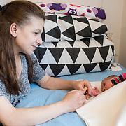 February 2016, Asylcenter Dianalund, Denmark. <br /> Aysha next to her 2 week old baby Julie in their room.