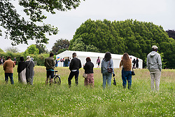© Licensed to London News Pictures; 19/06/2021; Bristol, UK. A pop-up vaccination clinic offering the Pfizer vaccination against Covid-19 coronavirus opens in Bristol's Eastville Park run by the Bristol CCG. The queue for jabs, with many of them young people, stretched half way down the park as walk-in vaccine clinics open in England in a major push to offer coronavirus jabs to all remaining adults to counter the recent increase in cases of covid with the spread of the Delta variant. Photo credit: Simon Chapman/LNP.