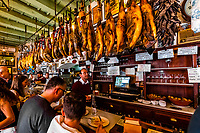 Tapas Bar La Teresas with dry cured hams hanging from the ceiling, Seville, Spain.