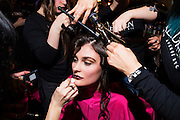 TORONTO, ON - MARCH 15: A model is swarmed while getting prepared for the House of Knot show during Toronto Fashion Week in Toronto, Ontario. Toronto Star/Todd Korol