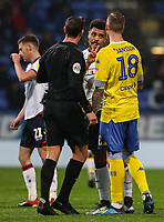 Bolton Wanderers' Josh Magennis raises an issue with Leeds United's Pontus Jansson and referee Robert Jones <br /> <br /> Photographer Andrew Kearns/CameraSport<br /> <br /> The EFL Sky Bet Championship - Bolton Wanderers v Leeds United - Saturday 15th December 2018 - University of Bolton Stadium - Bolton<br /> <br /> World Copyright © 2018 CameraSport. All rights reserved. 43 Linden Ave. Countesthorpe. Leicester. England. LE8 5PG - Tel: +44 (0) 116 277 4147 - admin@camerasport.com - www.camerasport.com