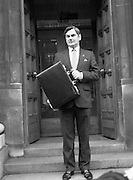 Ray McSharry On Budget Day.  (R71)..1988..27.01.1988..01.27.1988..27th January 1988..Mr Ray McSharry TD, Minister for Finance,presented his budget in Dáil Éireann today...Image shows the Minister for Finance, Ray McSharry, with the case containing the budget  as he departs the Department of Finance for the short walk to Dáil Éireann.