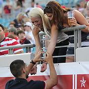 Clint Dempsey signs autographs prior to an international friendly soccer match between Scotland and the United States at EverBank Field on Saturday, May 26, 2012 in Jacksonville, Florida.  The United States won the match 5-1 in front of 44,000 fans. (AP Photo/Alex Menendez)