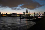 View looking across the River Thames to the skyline of Tower Bridge and The Shard in London, UK. One of the World's most famous cityscapes from Wapping towards this most iconic of skylines.