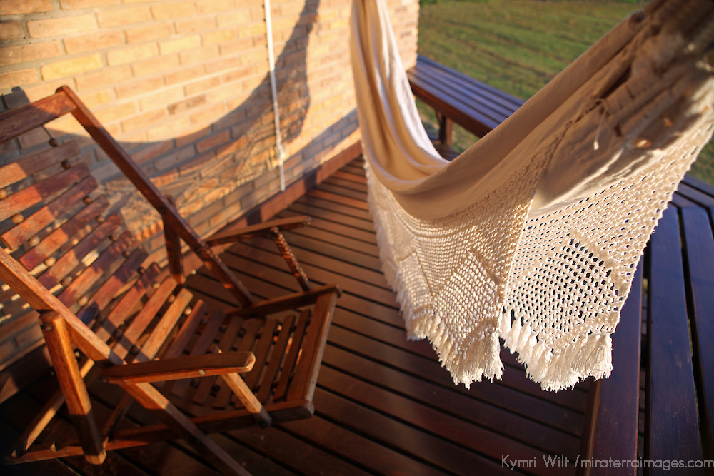 South America, Brazil, Pantanal. Private deck and hammock for each room at the Cordilheira Lodge of the Caiman Ecological Reserve.