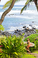 Olympic skier Julia Mancuso heading out to surf near her home on the island of Maui, Hawaii