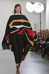 © Licensed to London News Pictures. 17 February 2014, London, England, UK. A model walks the runway at the Issa show during London Fashion Week AW14 at the Serpentine Sackler Gallery. Photo credit: Bettina Strenske/LNP