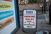 NHS smoking kills sign outside a pharmacy in London, England, United Kingdom.