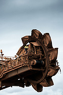 A worker operates an iron ore reclaimer at a mine site in the Pilbara region of Western Australia