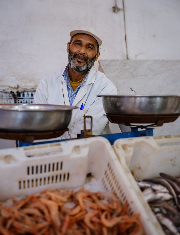 CASABLANCA, MOROCCO - CIRCA APRIL 2017: Fish seller at the fish market in Casablanca