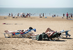 © Licensed to London News Pictures;20/07/2021; Weston-super-Mare, UK. People enjoy the beach during an extreme heatwave warning across the south west of England. Temperatures are expected to be 30 degrees centigrade or more in the south west. Photo credit: Simon Chapman/LNP.