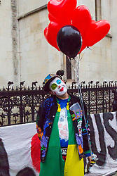 London - Alleged computer hacker Lauri Love arrives at the Royal Courts of Justice in London , pushing a mobile sound system playing electronic music, to find out whether he has successfully challenged a ruling that he can be extradited to the US, following allegations that he hacked United States government websites. A Supporter dressed as a clown stands outside the court. February 05 2018.