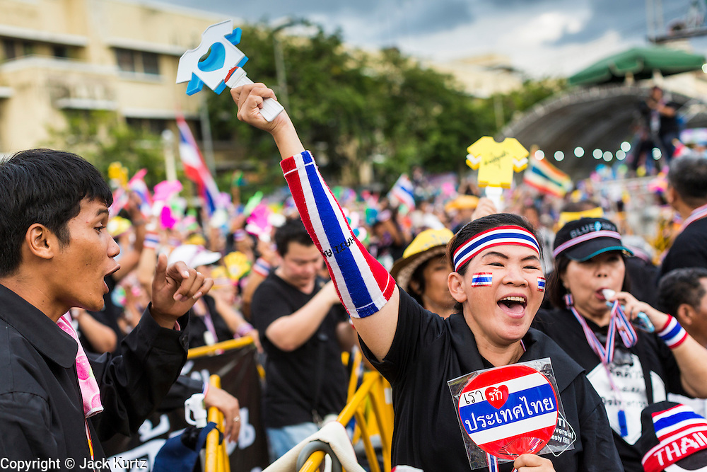 "15 NOVEMBER 2013 - BANGKOK, THAILAND: People cheer anti-government speakers during a protest rally in Bangkok. Tens of thousands of Thais packed the area around Democracy Monument in the old part of Bangkok Friday night to protest against efforts by the ruling Pheu Thai party to pass an amnesty bill that could lead to the return of former Prime Minister Thaksin Shinawatra. Protest leader and former Deputy Prime Minister Suthep Thaugsuban announced an all-out drive to eradicate the ""Thaksin regime."" The protest Friday was the biggest since the amnesty bill issue percolated back into the public consciousness. The anti-government protesters have vowed to continue their protests even though the Thai Senate voted down the bill, thus killing it for at least six months.     PHOTO BY JACK KURTZ"