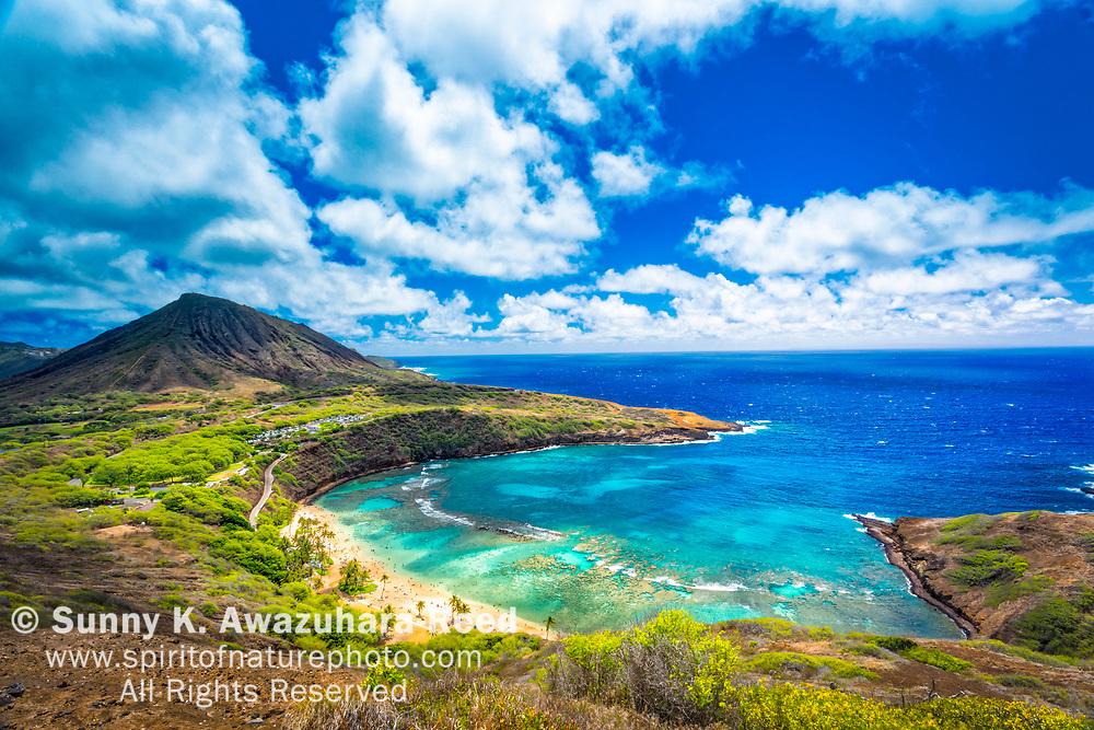 Aerial view of Hanauma Bay, Koko Head and Pacific Ocean under blue sky. Honolulu, Oahu Island, Hawaii.