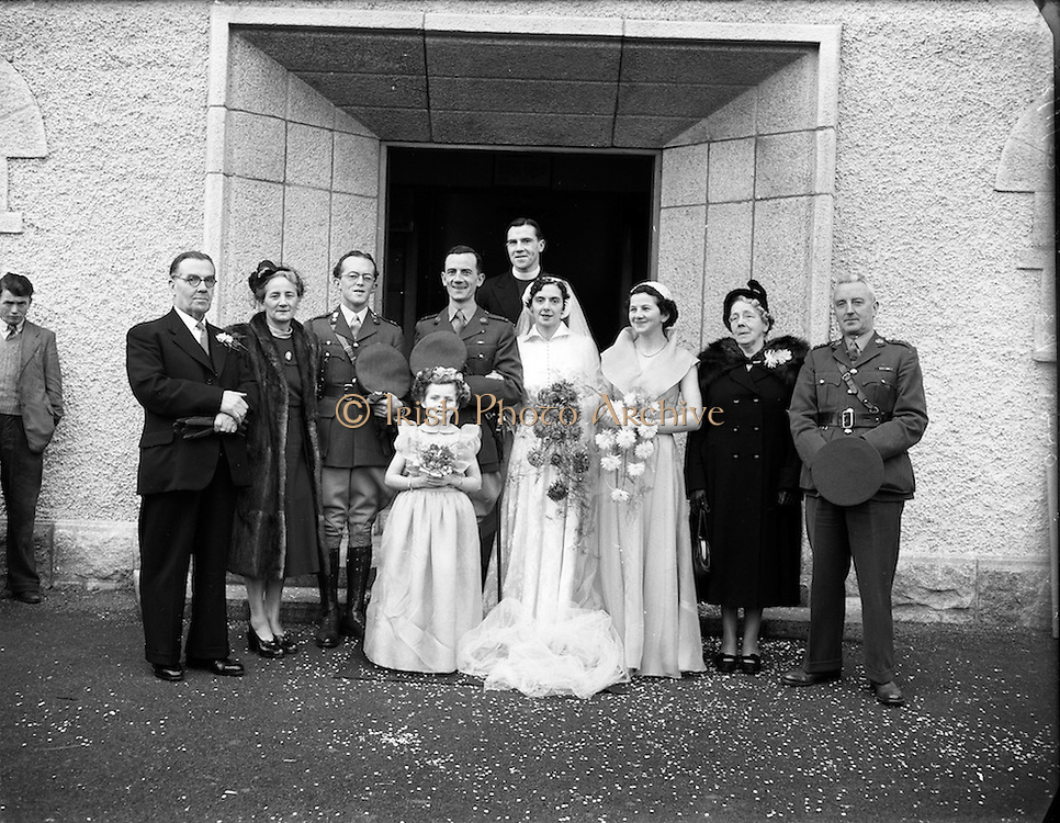 18/11/1952<br /> 11/18/1952<br /> 18 November 1952<br /> Wedding of Lieutenant Seamus Lillis, (son of Colonel James Lillis, Army Chief of Staff) Collins Barracks, Cork and Miss Aureed Mundy, Donegal at Ross Nuala and Bundoran, Co. Donegal. The wedding party outside the church at Ross Nuala. On the right is Col. Lillis.