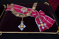 The British Empire Collar and Grand Masters Badge, and the British Empire Breast Star and Badge sewn onto a cushion in St James's Palace, London. The cushions displaying medals and decorations conferred on the Duke of Edinburgh by the United Kingdom and other countries across the world, together with his Field Marshal's baton and Royal Air Force Wings, and insignia from Denmark and Greece, will be placed on the altar in St George's Chapel, in Windsor, ahead of his funeral on Saturday. Picture date: Tuesday April 13, 2021.