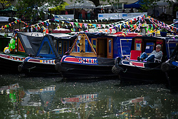 © Licensed to London News Pictures.30/04/2017.London, UK. A man rests on the sunshine as the Canalway Cavalcade festival takes place in Little Venice, London on Saturday, 30 April 2017. Inland Waterways Association's annual gathering of canal boats brings around 130 decorated boats together in Little Venice's canals on May bank holiday weekend. Photo credit: Ben Cawthra/LNP