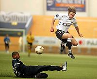 Fotball, 19 mars 2004, Treningskamp Lillestrøm-Sogndal 2-1, Alexander Ødegaard Sogndal, hopper over Emille Baron, Lillestrøm, og scorer mål