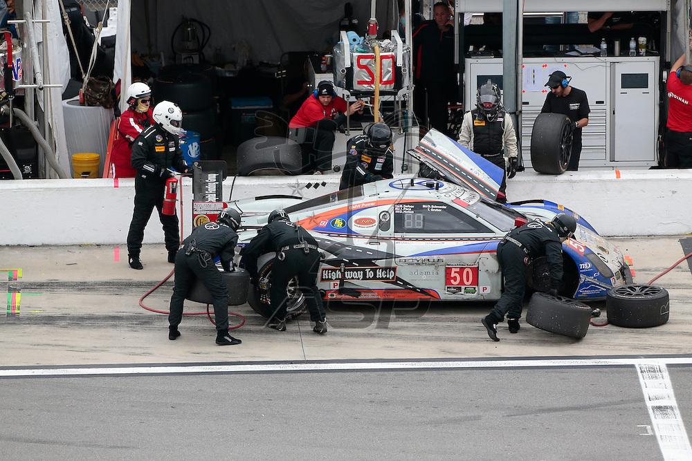 Daytona Beach, FL - Jan 31, 2016:  The IMSA WeatherTech Sportscar Championship teams take the checkered flag for the Rolex 24 at Daytona at Daytona International Speedway in Daytona Beach, FL.